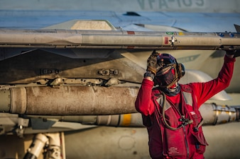 "Aviation Ordnanceman Airman Ethan Sauer performs pre-flight ordnance checks on a F/A-18E Super Hornet attached to the ""Gunslingers"" of Strike Fighter Squadron (VFA) 105 during flight operations aboard aircraft carrier USS Dwight D. Eisenhower (CVN 69) in the Arabian Sea."