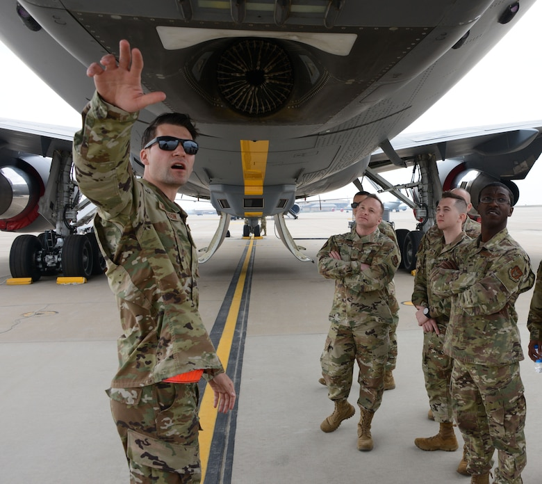 Tech. Sgt. Ian Michaelson, 931st Aircraft Maintenance Squadron, crew chief, gives recruiters from the 352nd Recruiting Squadron a tour of the KC-46 Pegasus during a recruiting event at McConnell Air Force Base, Kansas, Apr. 10, 2021.