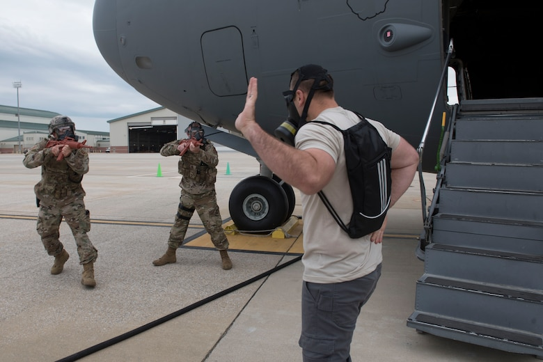 U.S. Air Force Senior Master Sgt. Nate Smith, right, a loadmaster and flight safety non-commissioned officer for the 167th Airlift Wing, plays the role of an aircraft hijacker as Staff Sgt. Bradley Knotts and Staff Sgt. Ryan Jenkins, with the 167th Security Forces, maneuver to apprehend him during a Counter CBRN (Chemical, Biological, Radiological, and Nuclear) All-Hazard Management Response, or CAMR, exercise at Shepherd Field, Martinsburg, West Virginia, April 30, 2021. CAMR is a hybrid program of classroom lecture, discussion and tabletop exercises that culminate in a full scale emergency response exercise.