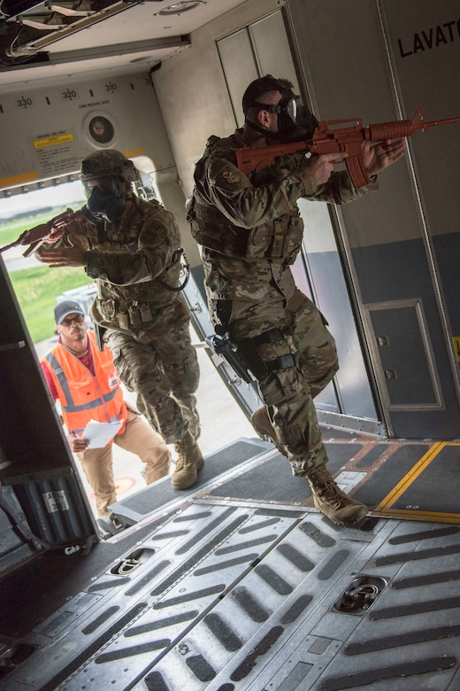 U.S. Air Force Staff Sgt. Bradley Knotts and Staff Sgt. Ryan Jenkins, with the 167th Security Forces Squadron, enter a C-17 Globemaster III aircraft during a Counter CBRN (Chemical, Biological, Radiological, and Nuclear) All-Hazard Management Response, or CAMR, exercise at the 167th Airlift Wing, Shepherd Field, Martinsburg, West Virginia, April 30, 2021. CAMR is a hybrid program of classroom lecture, discussion and tabletop exercises that culminate in a full scale emergency response exercise.