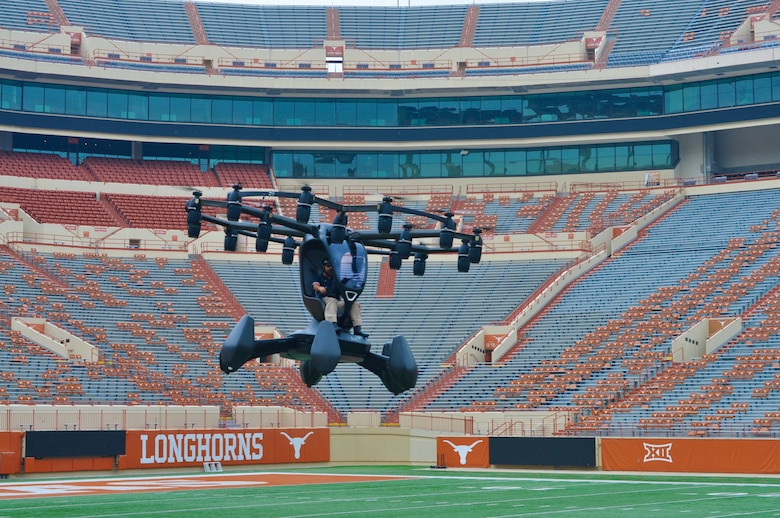"""LIFT Aircraft's """"Hexa"""" electric vertical takeoff and landing aircraft flies into the University of Texas at Austin football stadium for a live demonstration of this AFWERX Agility Prime collaboration during the April 9 event. (Photo courtesy of Joint Requirements Oversight Council)"""