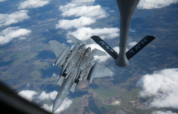 "A U.S. Air Force F-15E Strike Eagle aircraft assigned to the 48th Fighter Wing, flies away from a KC-135 Stratotanker aircraft assigned to the 100th Air Refueling Wing, above Latvia May 4, 2021. The 100th ARW is the only permanent U.S. air refueling wing in the European theater, providing the critical air refueling ""bridge"" which allows the Expeditionary Air Force to deploy around the globe at a moment's notice. (U.S. Air Force photo by Tech. Sgt. Emerson Nuñez)"