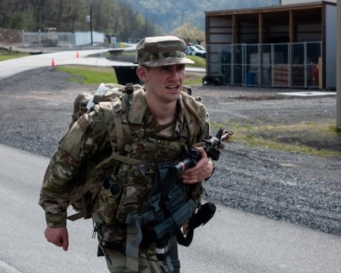 U.S. Air Force Staff Sgt. Anthony Zygmunt, a security forces specialist for the 167th Airlift Wing, competes in the six-mile ruck march event at the 2021 West Virginia Best Warrior competition at Camp Dawson in Kingwood, West Virginia, Apr. 23, 2021. The ruck march was timed and was the first of many events at the competition