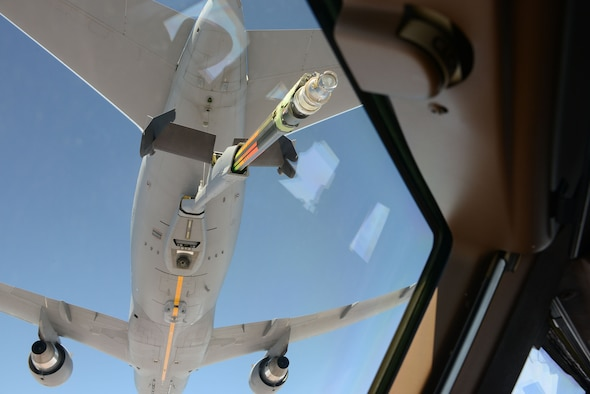 A KC-46 Pegasus approaches another KC-46 as the boom is about to attach for refueling during a training mission.