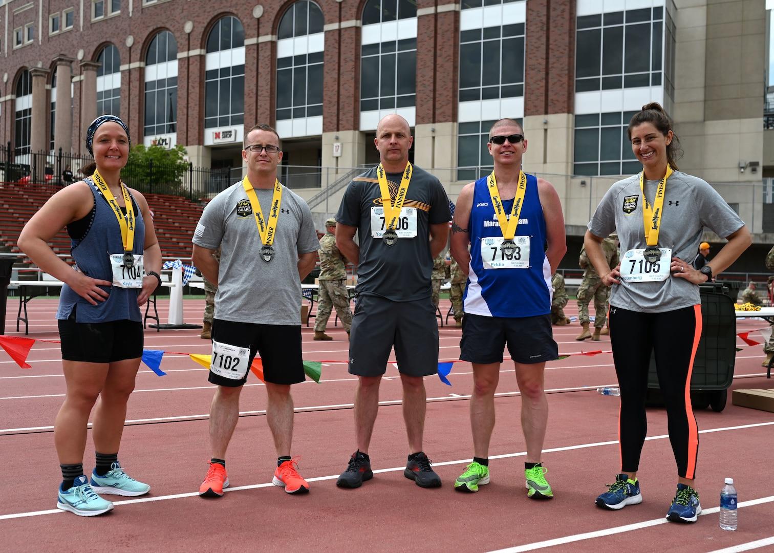 The 2021 New Hampshire National Guard Marathon Team poses at University of Nebraska's Ed Weir Stadium following their May 2, 2021, Lincoln Marathon finish.