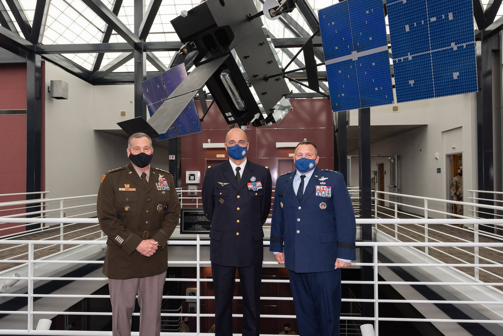 U.S. Army general, French Air Force general and U.S. Air Force general pose for a photo at U.S. Space Command headquarters.