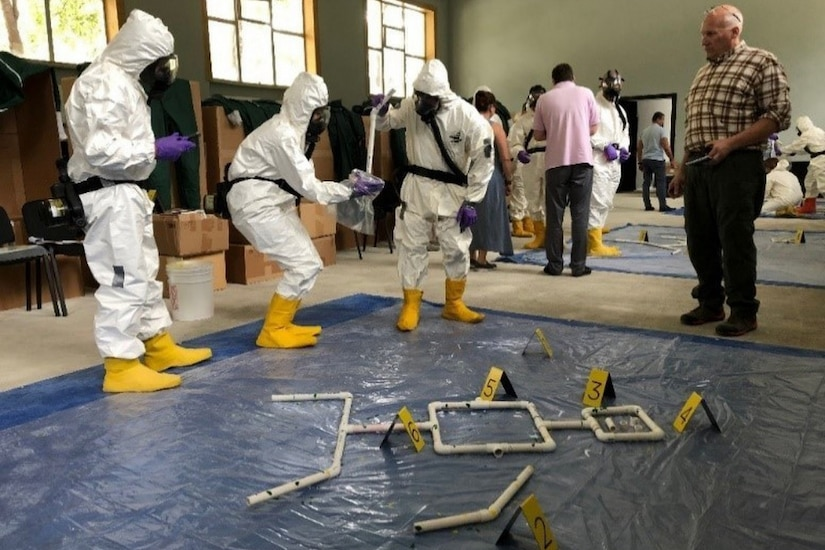 A Defense Threat Reduction Agency weapons of mass destruction crime scene operations course is shown.
