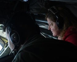 Congressional staff member Kelly Goggin lays next to Tech. Sgt. Mark Simmons, 756th Air Refueling Squadron boom operator, as he demonstrates how to operate the boom during flight May 4, 2021, out of Joint Base Andrews, Md. The congressional staff members visited the wing to observe an air refueling mission with an E-8C Joint STARS aircraft. (U.S. Air Force photo by Staff Sgt. Cierra Presentado/Released)
