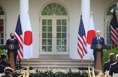 Japan's Prime Minister Yoshihide Suga and U.S. President Joe Biden hold a joint news conference in the Rose Garden at the White House in Washington, April 16, 2021.
