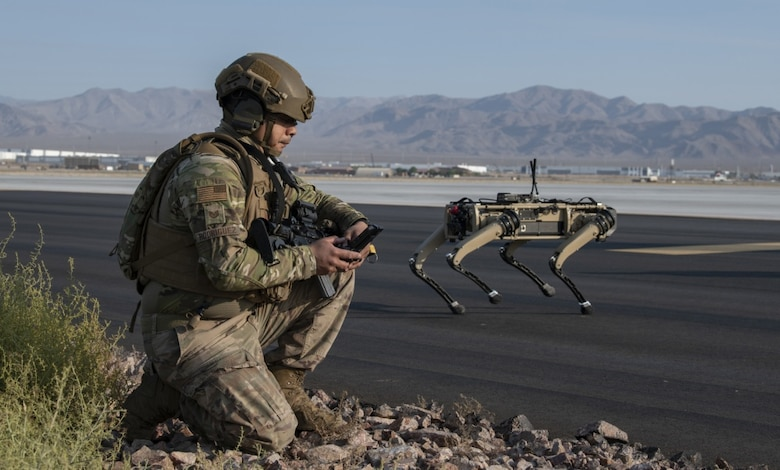 Tech. Sgt. John Rodiguez, 321st Contingency Response Squadron security team, provides operates a Ghost Robotics Vision 60 prototype at a simulated base during the second Advanced Battle Management System On-Ramp exercise at Nellis Air Force Base, Nevada, in Sept. 2020. These 'dogs' are semi-autonomous robots equipped with artificial intelligence to (U.S. Air Force photo by Tech. Sgt. Cory D. Payne)