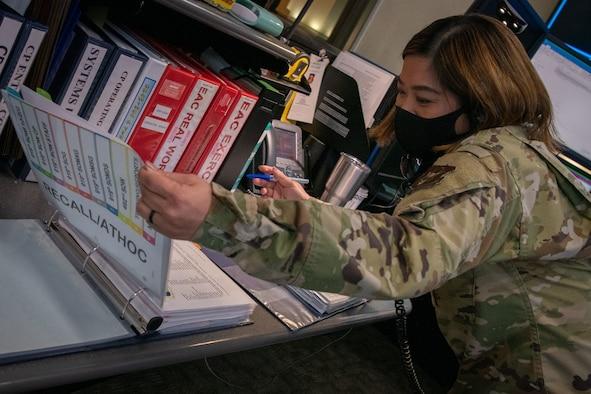 Airman opens binder.