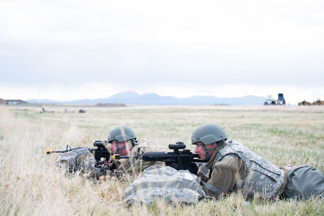 Senior Airman Terry Pittman and Airman Thomas Snow, 819th RED HORSE SQUADRON water and fuels system maintenance technicians, perform perimeter security during an exercise May 4, 2021, at Malmstrom Air Force Base, Mont.