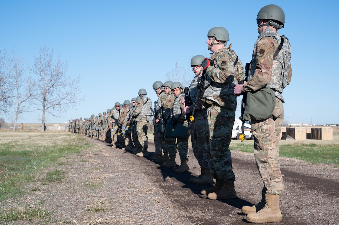 Airmen from the 819th RED HORSE Squadron prepare to perform a security sweep of the area to check for hazards during an exercise May 3, 2021, at Malmstrom Air Force Base, Mont.
