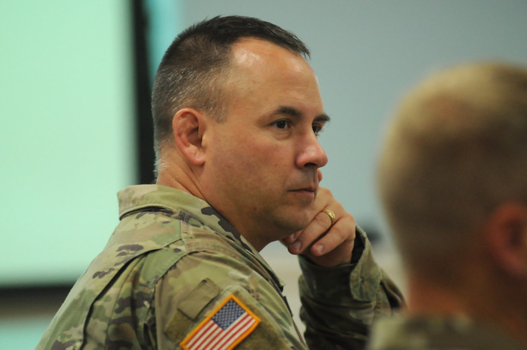Lt. Col. John Grabowski, deputy commander for cyber transformation at Fort Gordon, participates in a Battle Update Brief Sept. 27, 2018, at Military Ocean Terminal Sunny Point, N.C., or MOTSU, following Hurricane Florence's landfall.