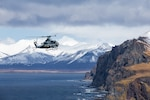 A U.S. Marine Corps AH-1Z Viper assigned to Marine Medium Tiltrotor Squadron 164 (Reinforced), 15th Marine Expeditionary Unit flies over the Gulf of Alaska in support of Northern Edge 2021. U.S. service members are participating in a joint training exercise hosted by U.S. Pacific Air Forces May 3-14, 2021, on and above the Joint Pacific Alaska Range Complex, the Gulf of Alaska, and temporary maritime activities area. NE21 is one in a series of U.S. Indo-Pacific Command exercises designed to sharpen the joint forces' skills; to practice tactics, techniques, and procedures; to improve command, control and communication relationships; and to develop cooperative plans and programs.