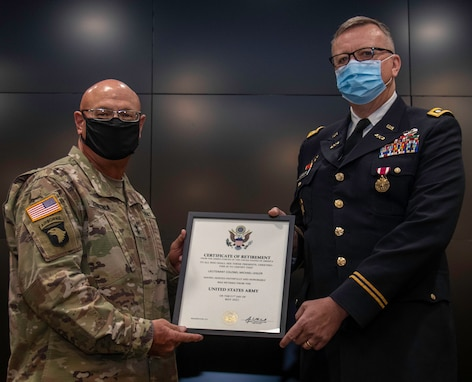 Illinois Army National Guard Lt. Col. Michael Legler (right), of Pekin, Illinois, receives a Certificate of Retirement from Maj. Gen. Michael Zerbonia, of Chatham, Illinois, Assistant Adjutant General – Army, during his retirement ceremony April 30 at the Illinois Military Academy, Camp Lincoln in Springfield, Illinois.