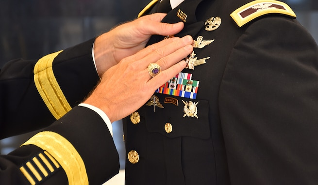 "Col. Andrew R. ""Drew"" Morgan receives the Army astronaut device from Lt. Gen. Daniel L. Karbler, commanding general of U.S. Army Space and Missile Defense Command, during a May 5 ceremony at the National Museum of the United States Army at Fort Belvoir, Virginia. (Photo by Ronald Bailey)"