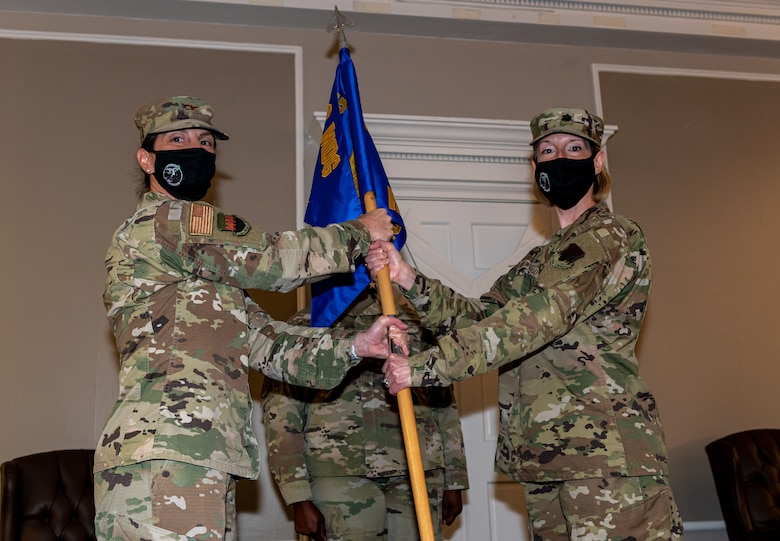 A photo of Airmen holding a flag.