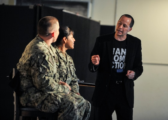 """Mike Domitrz, right, delivers the interactive show """"Can I Kiss You?"""" to service members at Camp Lemonnier, Djibouti on March 6, 2014."""