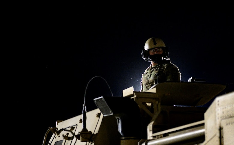 A U.S. Army Soldier waits for direction atop a High Mobility Artillery Rocket System April 27, 2021, at Mountain Home Air Force Base, Idaho. The HIMARS was used both as a simulated offensive capability as part of exercise Rainier War and as a means of training for various air mobility units who were able to familiarize the system's configuration within cargo aircraft such as the C-17 Globemaster III.