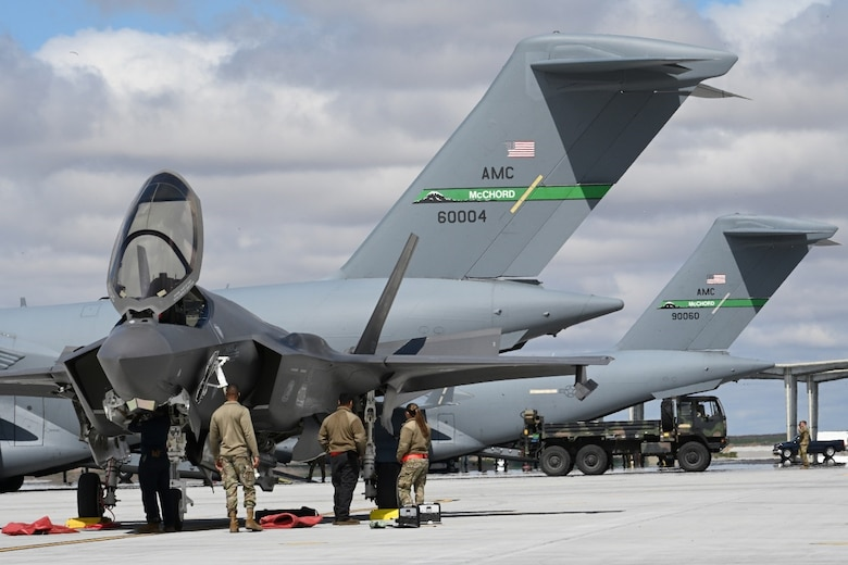 Airmen from Hill Air Force Base, Utah, observe an F-35 Lightning II April 26, 2021, on the flight line at Mountain Home AFB, Idaho. Airmen across the western United States participated in exercise Rainier War, testing their abilities to employ air combat capabilities during a time of potentially imminent foreign aggression.