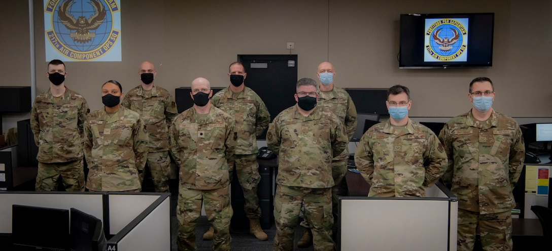 Members of the 110th Wing (pictured from left to right), Senior Airman Donovan Wentworth, 110th Communications Flight; Staff Sgt. Jennifer Rumsey, Tech. Sgt. Justin Oosterbaan, Lt. Col. Daniel Fawcett, Tech. Sgt. Robert Zellers, Master Sgt. Brian Leonard, Tech. Sgt. Lewis Banks, Staff Sgt. Robert Rainone, 217th Air Component Operations Squadron and Staff Sgt. Ryan Swartzendruber, the 110th Operations Group, stands for a team photo on April 29, 2021, at Battle Creek Air National Guard Base, Battle Creek, Mich.