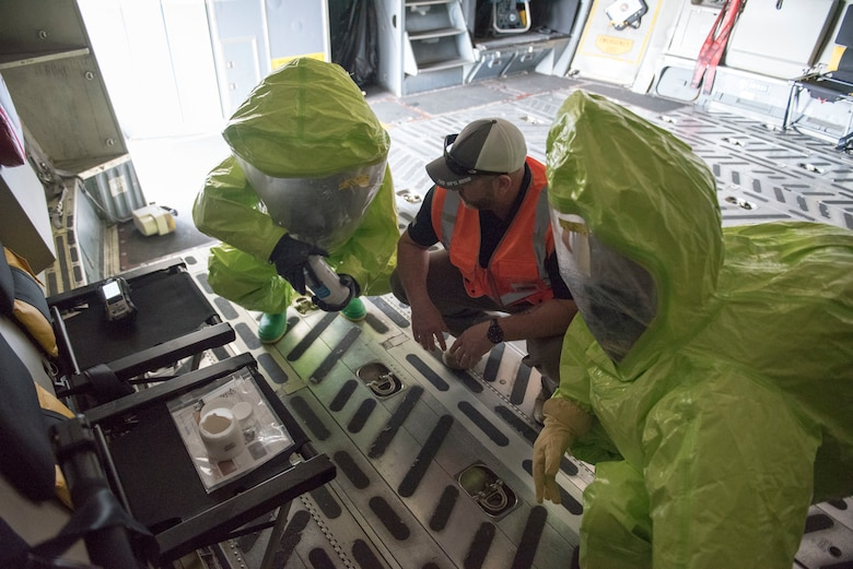 Chris Keesee, center, CBRN training project manager for Federal Resources, assists U.S. Air Force 1st Lt Samuel Gerard, with 167th bioenvironmental engineering, and Staff Sgt. Austin Lloyd, 167th Airlift Wing firefighter, as they test an unknown substance on a C-17 Globemaster III aircraft as part of a Counter CBRN (Chemical, Biological, Radiological, and Nuclear) All-Hazard Management Response, or CAMR, exercise at the 167th AW, Shepherd Field, Martinsburg, West Virginia, April 30, 2021. CAMR is a hybrid program of classroom lecture, discussion and tabletop exercises that culminate in a full scale emergency response exercise.