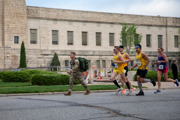 National Guard members run in front of the Nebraska State Capitol building on Sunday, May 2, 2021, during the annual Lincoln Marathon.