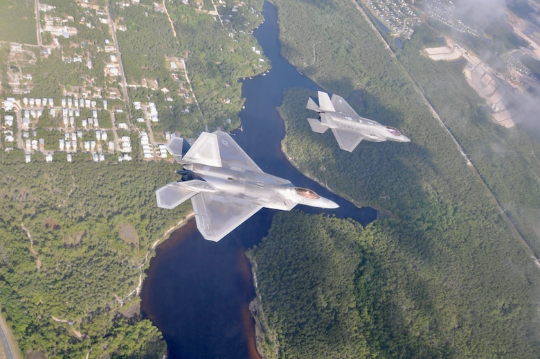 A F-22 Raptor from the 325th Fighter Wing flies alongside a F-35 Lightning II from the 33rd Fighter Wing over the Emerald Coast. The fifth generation fighter jets flew together in a rare dissimilar formation to salute healthcare workers, first responders and other essential employees May 15, 2020. (U.S. Air Force photo by 1st Lt Savanah Bray)
