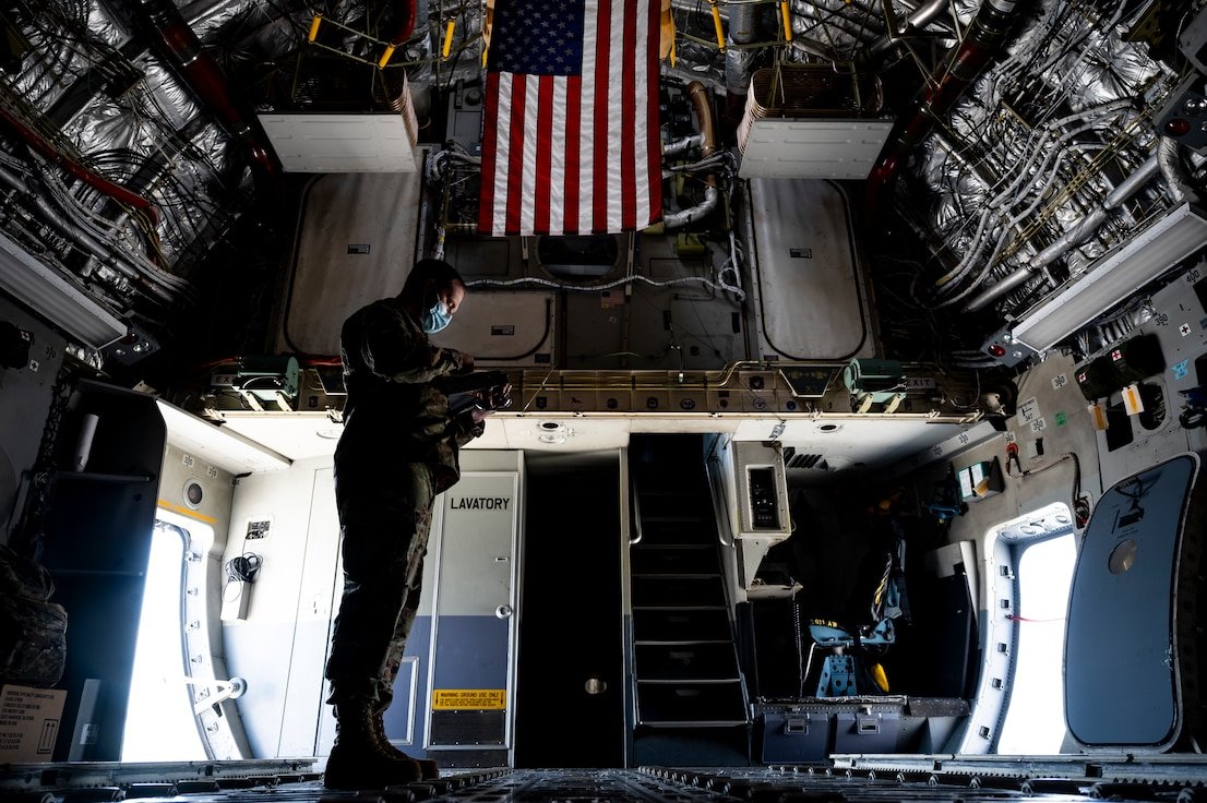 Master Sgt. Jai Kilmer, 911th Aircraft Maintenance Squadron quality assurance technician, reviews a checklist while inspecting maintenance procedures on a C-17 Globemaster III at the Pittsburgh International Airport Air Reserve Station, Pennsylvania, April 27, 2021.