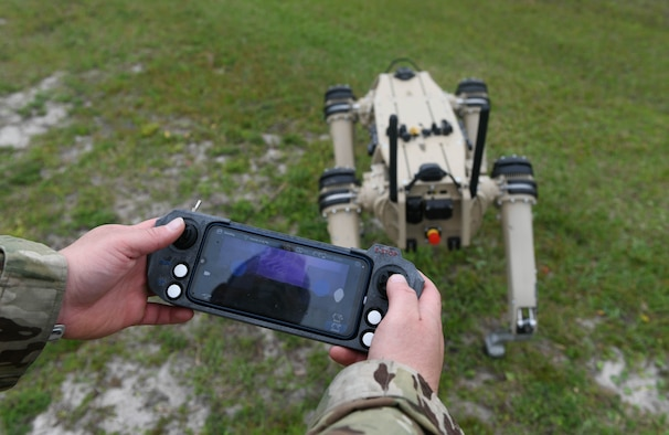 Master Sgt. Krystoffer Miller, 325th Security Forces Squadron operations support superintendent, operates a Quad-legged Unmanned Ground Vehicle at Tyndall Air Force Base, Fla., March 24, 2021. The purpose of the Q-UGV is to add an extra level of protection to base. (U.S. Air Force photo by Airman 1st Class Anabel Del Valle)