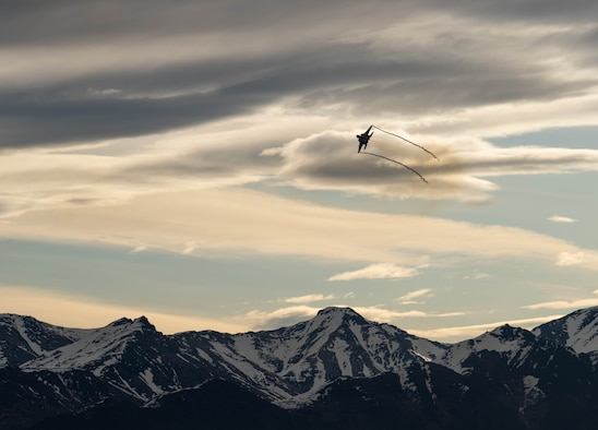 F-15EX flies over mountains