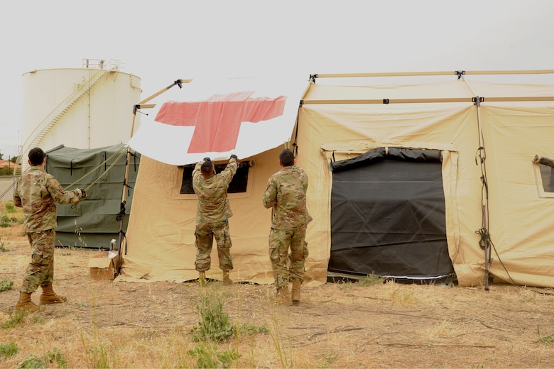 Image of Airmen setting up a tent.