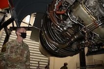 Senior Master Sgt. Robert Thames, the recruiting flight chief at Whiteman Air Force Base, Missouri, checks out the engine of a KC-46 Pegasus at the school house located at McConnell Air Force Base, Kansas, Apr. 9, 2021