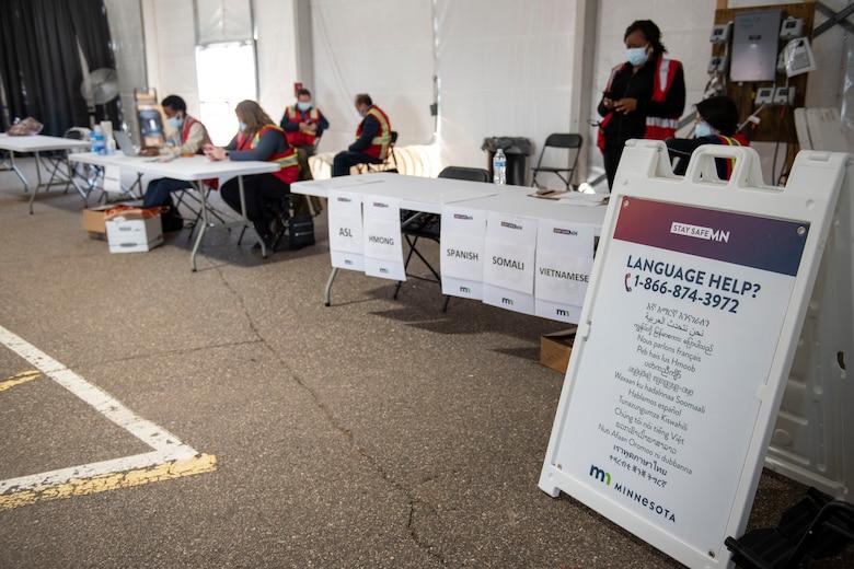 Language translators assist the community at a community vaccination center.