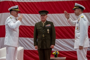 Vice Adm. Sam Paparo, left, commander, U.S. Naval Forces Central Command (NAVCENT), U.S. 5th Fleet and Combined Maritime Forces (CMF), is relieved by Vice Adm. Brad Cooper, right, during a change of command ceremony presided over by Gen. Frank McKenzie, commander of U.S. Central Command, onboard Naval Support Activity Bahrain, May 5. NAVCENT is the U.S. Navy element of U.S. Central Command in the U.S. 5th Fleet area of operations and encompasses about 2.5 million square miles of water area and includes the Arabian Gulf, Gulf of Oman, Red Sea and parts of the Indian Ocean. The expanse is comprised of 20 countries and includes three critical choke points at the Strait of Hormuz, the Suez Canal and the Strait of Bab al Mandeb at the southern tip of Yemen.