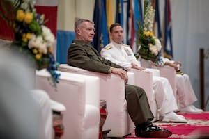 Gen. Frank McKenzie, commander of U.S. Central Command, center, and Vice Adm. Brad Cooper, incoming commander U.S. Naval Forces Central Command (NAVCENT), U.S. 5th Fleet and Combined Maritime Forces (CMF) listens to remarks during a change of command ceremony onboard Naval Support Activity Bahrain, May 5. Vice Adm. Sam Paparo was relieved by Cooper. NAVCENT is the U.S. Navy element of U.S. Central Command in the U.S. 5th Fleet area of operations and encompasses about 2.5 million square miles of water area and includes the Arabian Gulf, Gulf of Oman, Red Sea and parts of the Indian Ocean. The expanse is comprised of 20 countries and includes three critical choke points at the Strait of Hormuz, the Suez Canal and the Strait of Bab al Mandeb at the southern tip of Yemen.