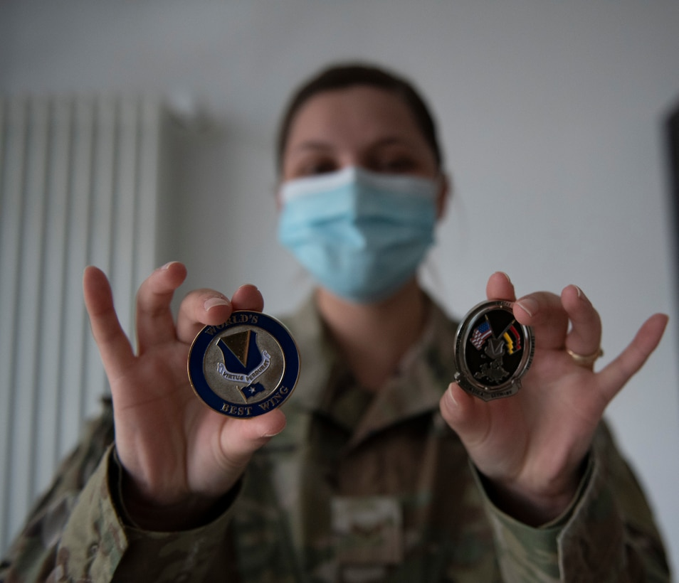Female Airman shows off challenge coins.