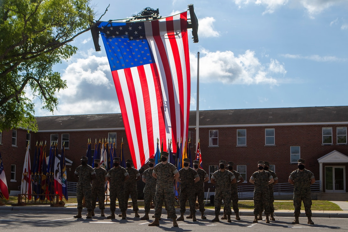 U.S. Marines with 2d Tank Battalion, 2d Marine Division (2d MARDIV), participate in a deactivation ceremony on Camp Lejeune, N.C., May 5, 2021. This is the next step towards 2d MARDIV's optimization for future conflicts against peer threats in accordance with the 38th Commandant's Planning Guidance and Force Design 2030. (U.S. Marine Corps photo by Pfc. Sarah Pysher)