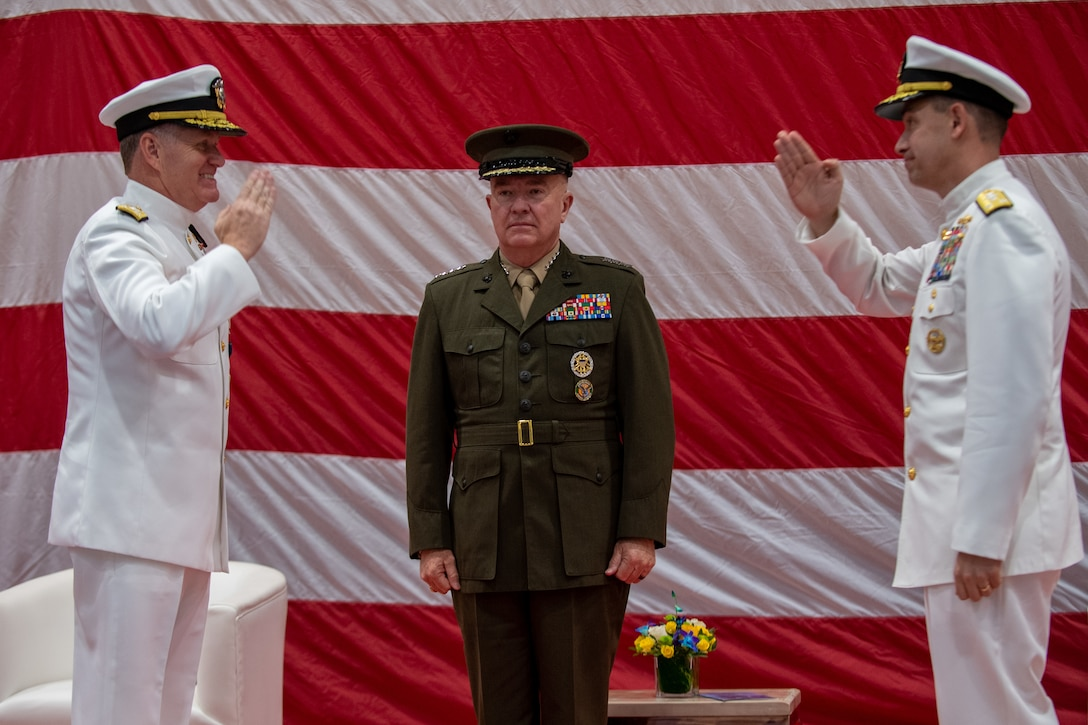 NAVAL SUPPORT ACTIVITY BAHRAIN (May 5, 2021) Vice Adm. Sam Paparo, left, commander, U.S. Naval Forces Central Command (NAVCENT), U.S. 5th Fleet and Combined Maritime Forces (CMF), is relieved by Vice Adm. Brad Cooper, right, during a change of command ceremony presided over by Gen. Frank McKenzie, commander of U.S. Central Command, onboard Naval Support Activity Bahrain, May 5. NAVCENT is the U.S. Navy element of U.S. Central Command in the U.S. 5th Fleet area of operations and encompasses about 2.5 million square miles of water area and includes the Arabian Gulf, Gulf of Oman, Red Sea and parts of the Indian Ocean. The expanse is comprised of 20 countries and includes three critical choke points at the Strait of Hormuz, the Suez Canal and the Strait of Bab al Mandeb at the southern tip of Yemen. (U.S. Navy photo by Mass Communication Specialist 1st Class Daniel Hinton)