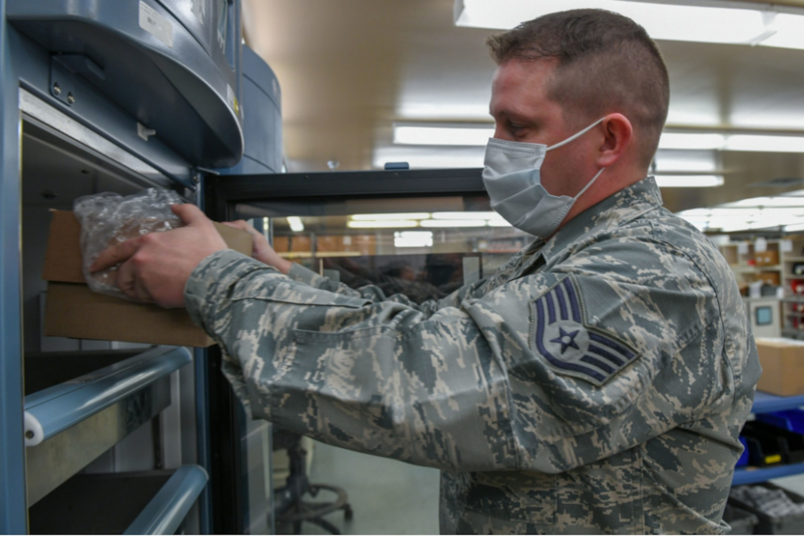 Staff Sgt. Bush Meister, 19th Medical Group NCO in charge of medical equipment, stores the first shipment of the Moderna COVID-19 Vaccine at Little Rock Air Force Base, Arkansas, Jan. 13, 2021.