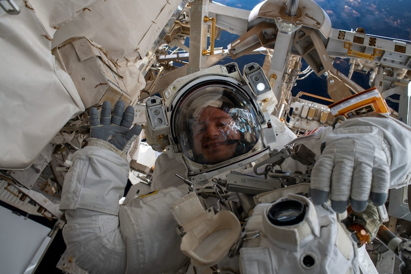 An astronaut walks in space.