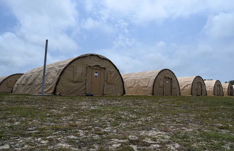 Tents are set in a field at the Agile Flag 21-2 experiment at Naval Outlying Landing Field Choctaw, Florida, May 3, 2021. The tents served as home and shelter for approximately 200 Airmen during the experiment. (U.S. Air Force photo by Senior Airman Sarah Dowe)