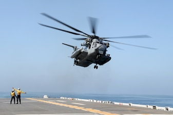 A CH-53 Super Stallion helicopter assigned to Marine Heavy Helicopter Squadron (HMH) 466 takes off from the amphibious assault ship USS Tripoli (LHA 7).