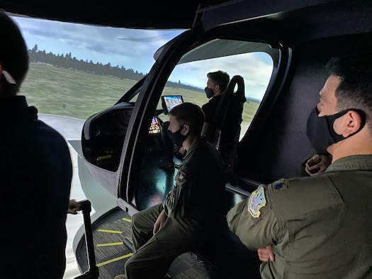 Air Force operators and engineers assess the BETA Technologies ALIA flight simulator. (Photo courtesy BETA Technologies)