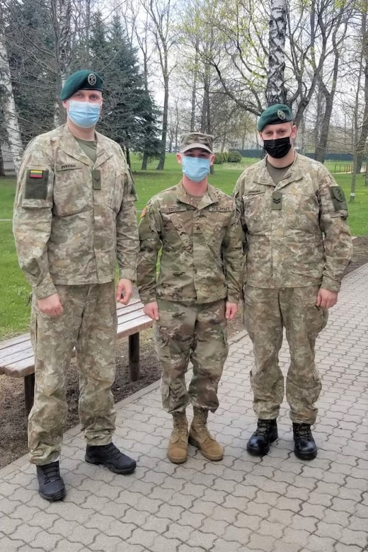 Sgt. Bradley Taylor, center, a medic with the Pennsylvania National Guard's 108th Medical Company Area Support, poses with two Lithuanian Army Soldiers on a Lithuanian Army base in Marijampole, Lithuania, where Taylor is providing medical support to U.S and Lithuanian troops. The 108th MCAS deployed to Europe in late February to provide medical support to U.S. and allied rotational forces in the region.