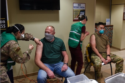 James Haleski, 30th Civil Engineer Squadron chief of readiness and emergency management, and Dr. Paul Vu, 30th Medical Group chief of aerospace medicine, receive COVID-19 vaccinations, Jan. 6, 2021, Vandenberg Air Force Base, Calif.