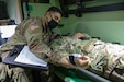 Army Reserve Sgt. Nick Garcia, a combat medic with the 407th Medical Company, 49th Medical Battalion, 332nd Medical Brigade, San Juan, Puerto Rico, reads the vitals of Pfc. Sanchez Lang, a combat medic with the 20th Engineer Battalion Headquarters and Headquarters Company, 36th Engineer Brigade, Ft. Hood, Texas. While many combat medics were taking part in Exercise Guardian Response 21, a multi-component Homeland Emergency Response Exercise run by the Army Reserve's 78th Training Division, medics like Garcia were on hand to respond to  real-world medical needs. (U.S. Army photo by Staff Sgt. Monte Swift)