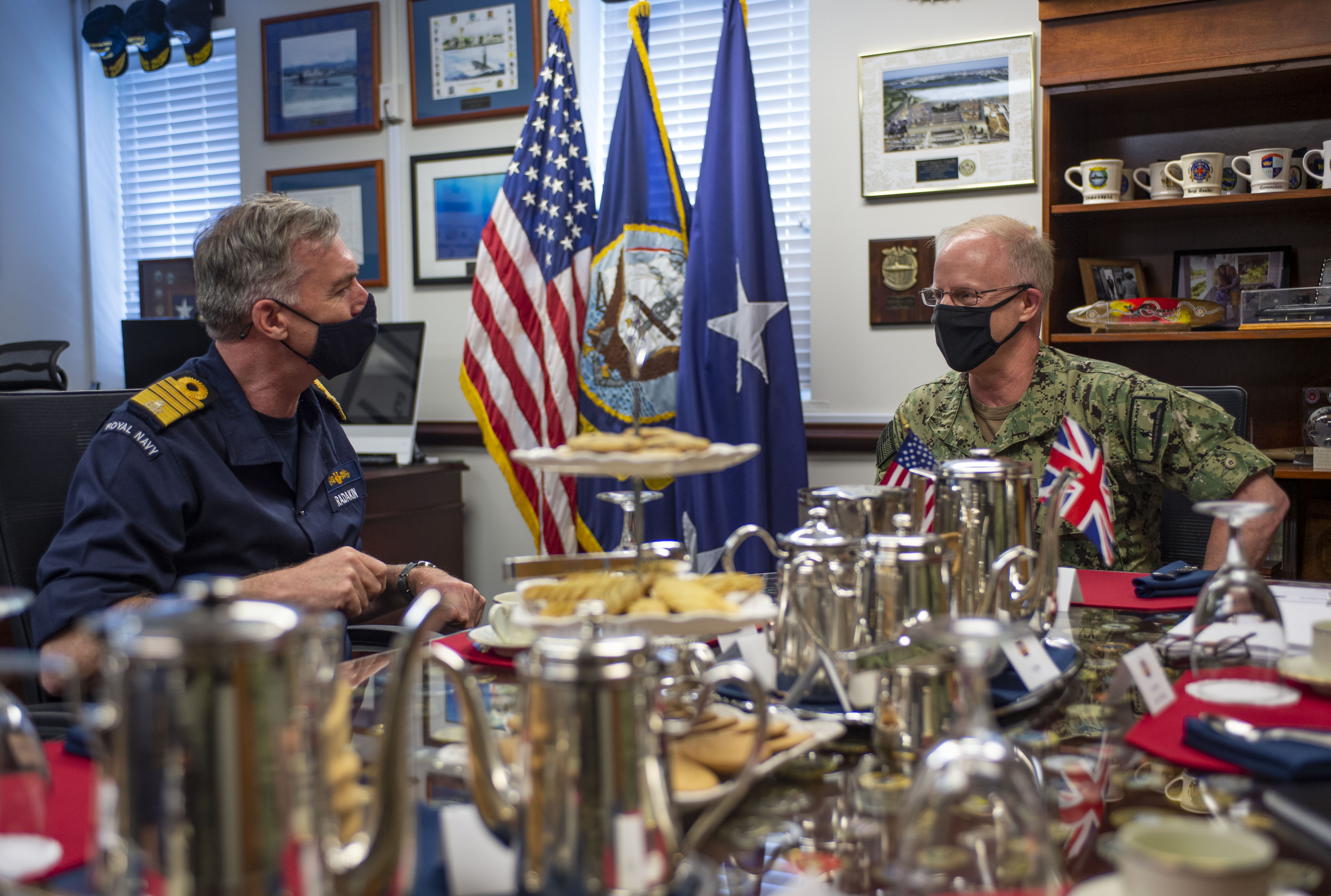 Commander, Submarine Forces Vice Adm. Daryl Caudle speaks with U.K. Royal Navy First Sea Lord and Chief of the Naval Staff Adm. Tony Radakin during an office call to Submarine Forces headquarters in Norfolk, Va., May 6, 2021.