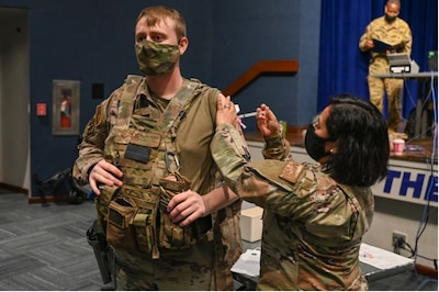Senior Airman Christian Cardwell, 45th Security Forces Squadron Defender, receives a COVID-19 vaccine at Patrick Space Force Base, Fla., Jan. 14, 2021.
